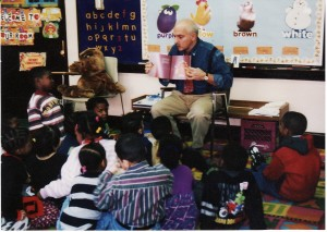 George reads to children copy
